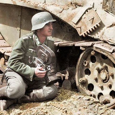 the_ww2_memoirs A Germans Kriegsberichter (War Correspondent) takes cover behind a BT-5 light tank and prepares to film the battle raging around him during Operation Barbarossa, June, 1941. War Correspondents are soldiers first and camera men second. They fought alongside the infantry and also filmed them and there ordeals for both propaganda and historical purposes. They risked their lives to document war so people like me could share the stories, facts, and secrets of the Second World…