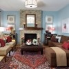 Blue Living Room Interior Design with Brown Corner Sofa