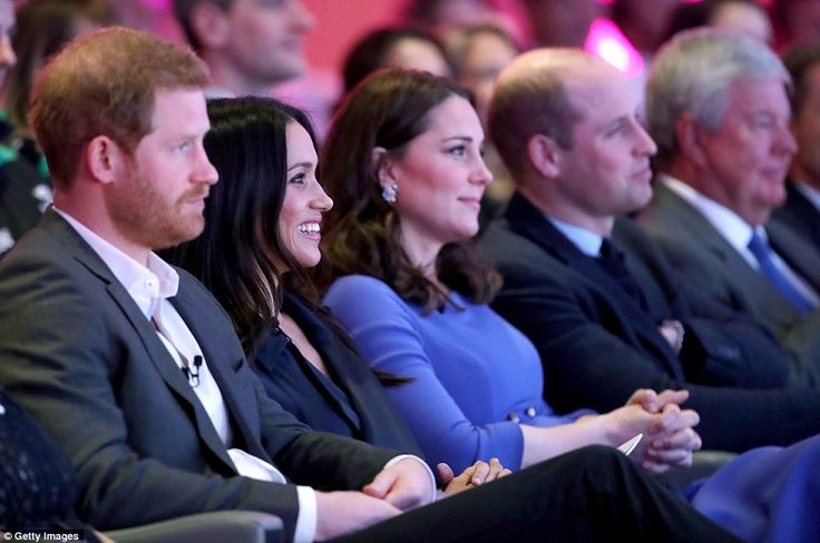 Meghan Markle and the Duchess of Cambridge, pictured with Harry and William, both wore blue for their first joint engagement together