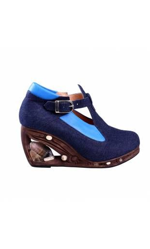Shoe compensated out of blue leather and heel out of wooden Absolutely Blue