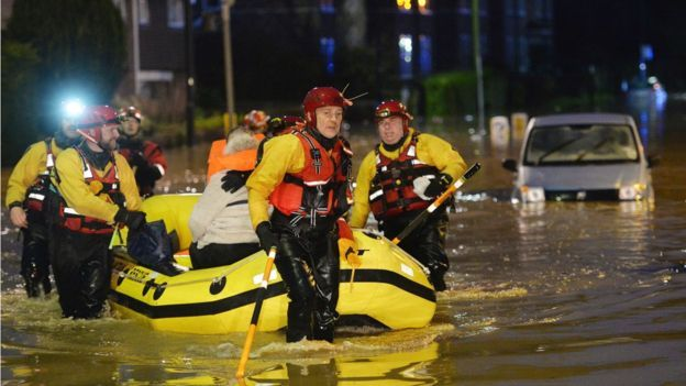 Some residents in York, are evacuated by members of a Mountain Rescue team