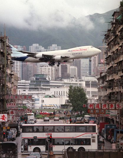 Kai Tak Airport, Hong Kong Now the stuff of legend, the white-knuckle approach to Kai Tak's runway 13 involved flying low over Hong Kong's densely populated residential districts. Shortly before landing, at a height of less than 1,000 feet, approaching aircraft were required to execute a sharp, and technically challenging, turn to the right to line up with the runway.