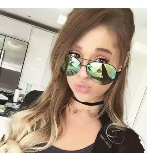 Ariana Grande wearing cool new sunglasses + showing off her Lugorous hair.:).