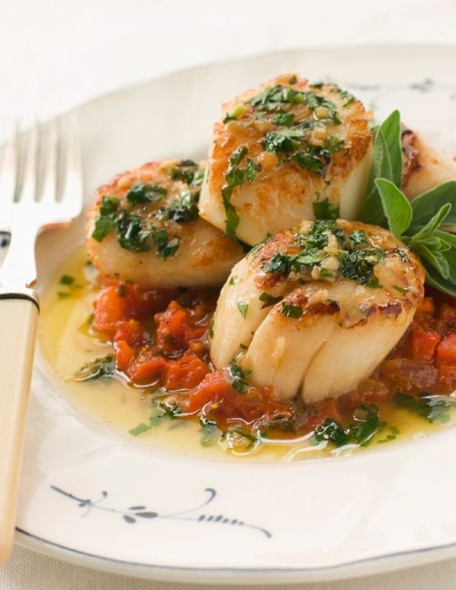 Pan-Seared Scallops with a roasted red pepper tapenade and garlic butter sauce.