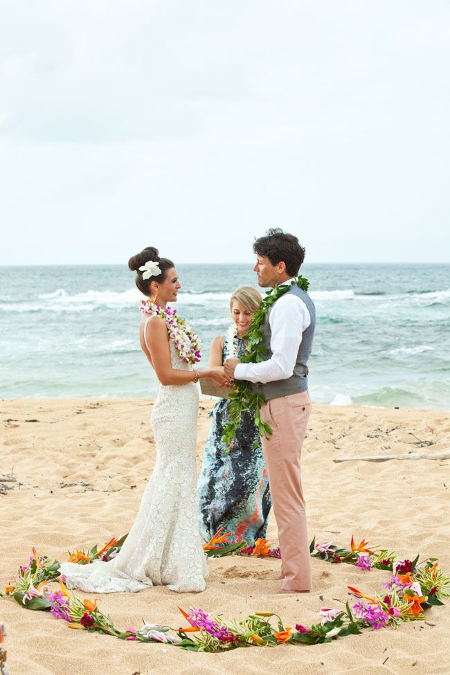 Hawaiian wedding ceremony complete with leis exchange for Honolulu wedding dress rental