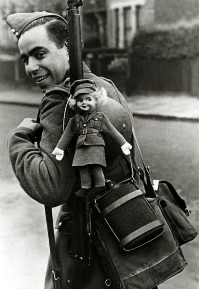 War and Conflict, World War Two, pic: 1939, A British 'Tommy' off to war carrying a luck mascot ATS, doll (Photo by Popperfoto/Getty Images)