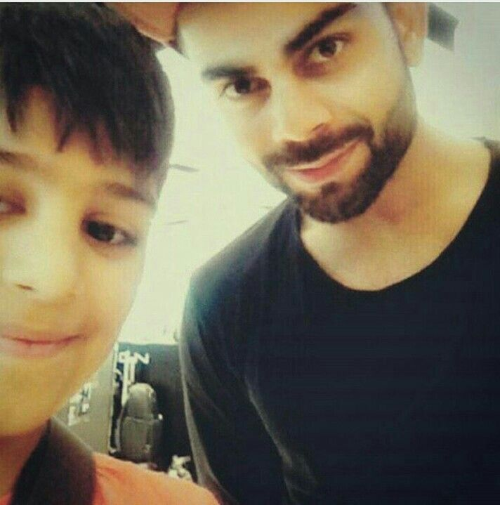 Virat kohli with a young fan