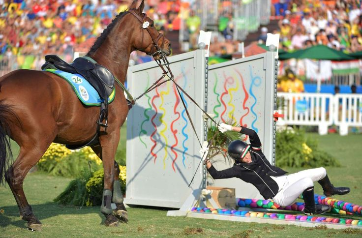 Whoa!     Hungary's Zsofia Foldhazi tries to hold onto her horse after crashing into an obstacle in the show jumping portion of the women's modern pentathlon event in Rio de Janeiro, on Aug. 19.