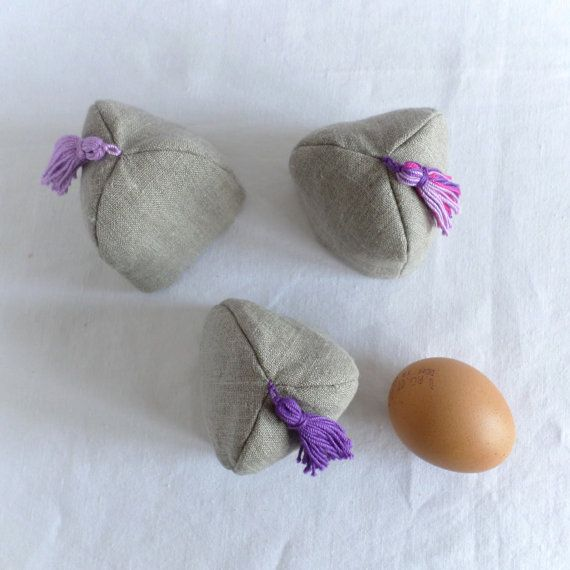 Egg cosy in natural linen colorful tassel on top. by TableStories