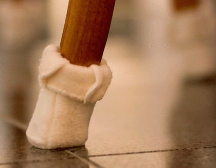 Clever fleece socks for the feet of chairs protects both noise & floor scratching.  Not a bad idea for the kitchen.