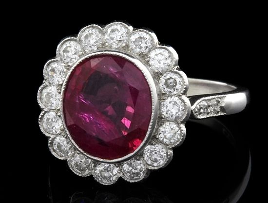 Antique Engagement Ring from Edwardian Period with 4.15 carat ruby in centre set in platinum