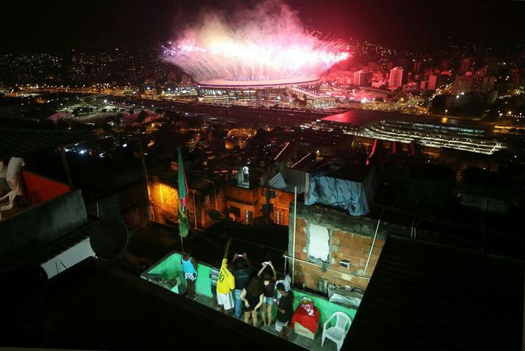 Residents of the Mangueira favela watch fireworks explode over Maracana stadium during the opening ceremonies of the 2016 Summer Olympics in Rio de Janeiro on Aug. 5
