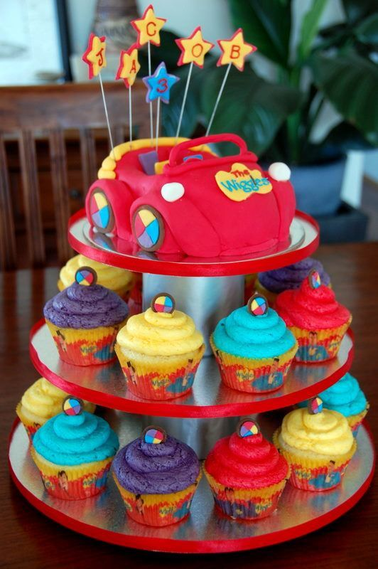 Wiggles Cupcake Tower - My first attempt at the Wiggles Big Red Car and Cupcakes. The car is carved out of white chocolate mud cake covered with fondant icing. This was for a friend's nephew 3rd birthday party.