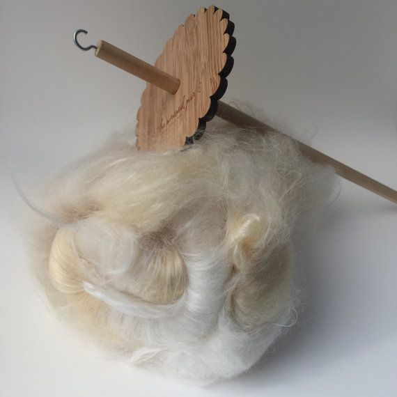 Spin your own unique and wonderful yarns with The Unusual Pear top whorl bamboo drop spindle. Each spindle is hand made with FSC certified bamboo