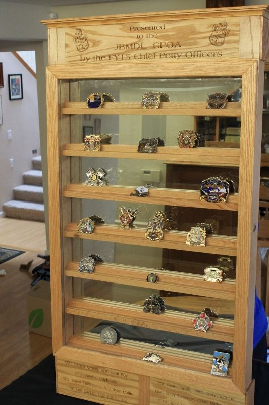 Wall mounted military challenge coin display.  Red oak, mirror back, locking door.  50 inches high by 28 inches wide.  Holds 100 coins.