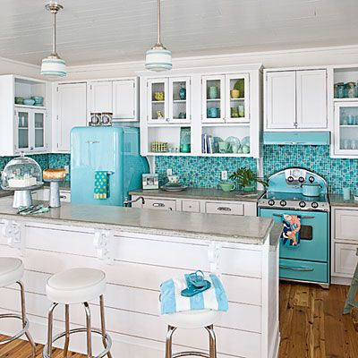 Get Retro Inspiration Mosaic turquoise tile, throwback appliances, and aqua accented pendant lights make this kitchen an undeniably happy space.