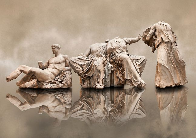 Figures from the East Pediment of the Parthenon, Acropolis Athens. From left to right cat no D Dionysos ,middle E & F Demeter & Persephone, left G Hebe. British Museum London Exhibit. |  © Paul Randall Williams 2012.