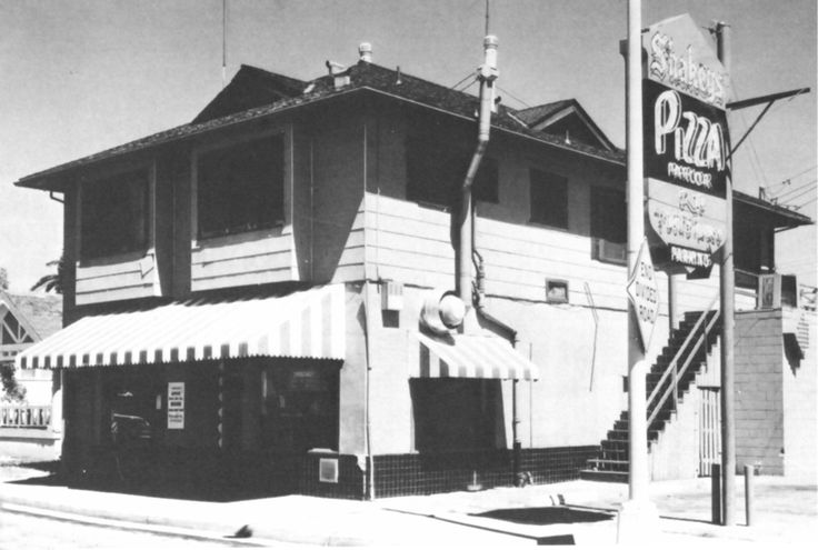 """The history of Shakey's Pizza Parlor begins in 1954, when Sherwood """"Shakey"""" Johnson opened the first Shakey's Pizza Parlor® in a remodeled grocery store on 57th and J Street in Sacramento, California."""