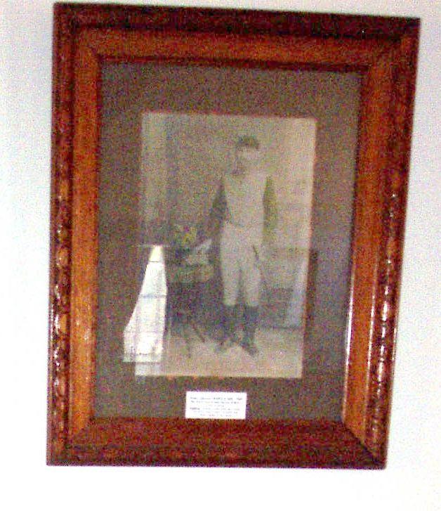 Framed photograph of Tom Criddle.