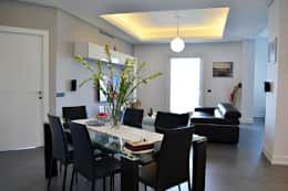 Zona Pranzo: Sala da pranzo in stile in stile Moderno di tizianavitielloarchitetto