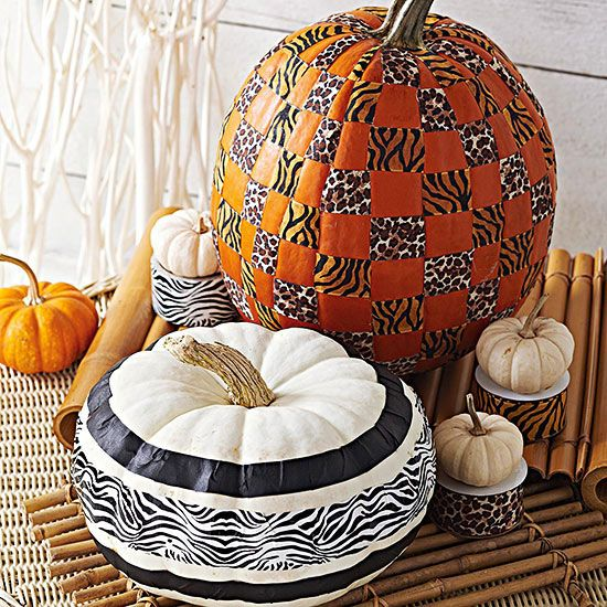 Stamped Pumpkins: Roller stamps can add fun visual texture to different colors of pumpkins. Here, a regular pattern of stripes and dots adds a checkerboard to an orange version, while a single roller with stripes updates a white one. - bhg #pumpkins #animalprint
