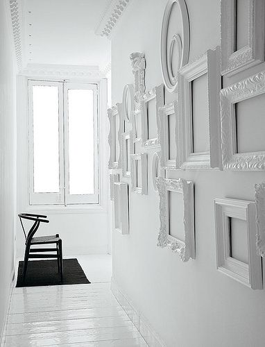 white on white    would like to leave blank and slowly fill over the years with b/w photos of friends, family, travels, slowly fill the wall like a timeline