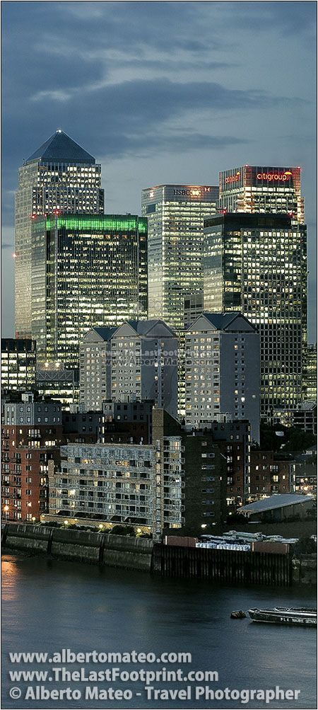 Canary Wharf Buildings next to River Thames at dusk. A beautiful aerial view of the Financial District of London, United Kingdom | Cityscape by Alberto Mateo Travel Photographer.