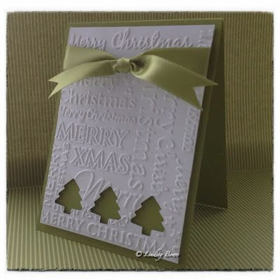 handmade Christmas card ... Christmas words embossed card front ... clean and simple style ... three punched trees leave open space for the green card to show through ...