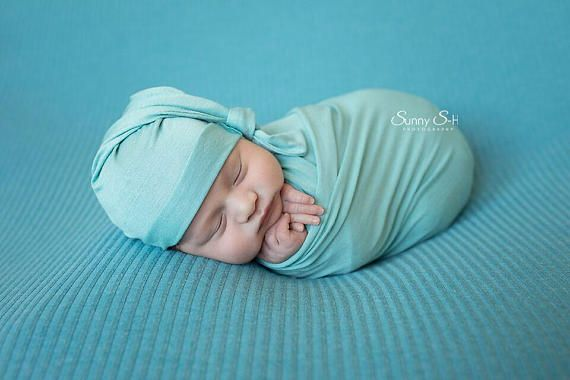 """Buttery soft, super-stretchy jersey knit newborn wraps. Pictured here in """"Lagoon"""" with optional sleepy hat, perfect for your next newborn session!"""