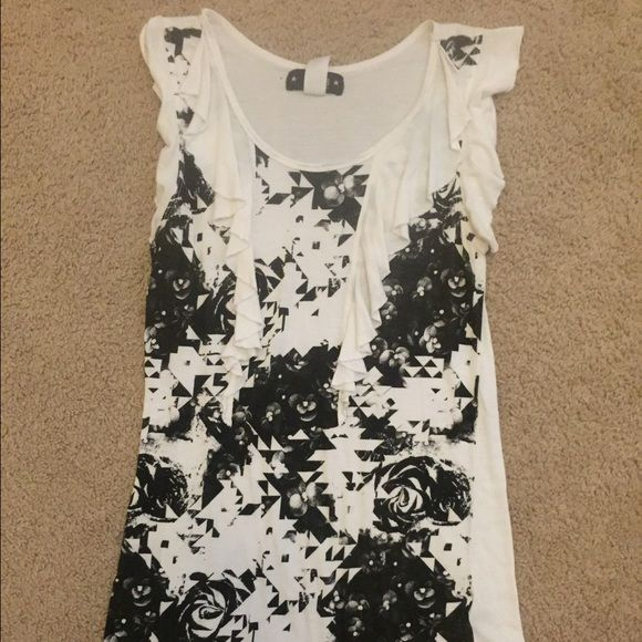 Abbey Dawn by Avril Levigne Sleeveless Top White, sleeveless Abbey Dawn by Avril Levigne top with black floral design. Slightly used condition but still has a lot of life left. No rips, tears or stains but there is a pin sized hole on back near the label and size tag (shown in 2nd pic). Abbey Dawn by Avril Levigne Tops
