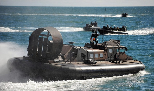 Picture shows a Royal Marine LCAC(LR) hovercraft with Royal Marine Off Shore Landing Craft in the background during Carlyon Bay Wader Exercise in Cornwall.
