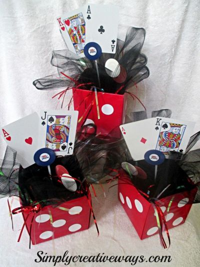 Casino themed centerpieces are easy to diy for a 50th birthday party.  See more 50th birthday party themes and party ideas at www.one-stop-party-ideas.com