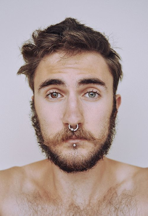 heterochromia, the condition of having two different colored irises. Besides that, the beard makes him even hotter