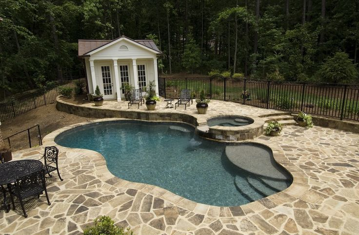 Inground Swimming Pool And Spa With Natural Stone Decking