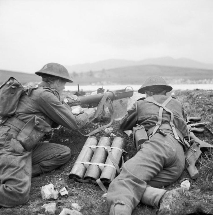 A PIAT (Projectile Infantry Anti-Tank) in action at a firing range in Tunisia, 19 February 1943.