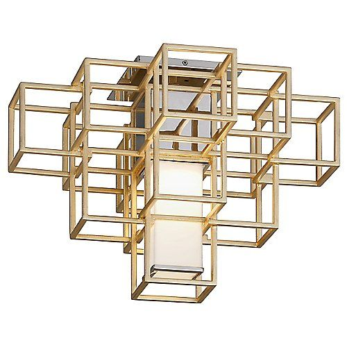 The Metropolis Semi-Flushmount from Corbett Lighting is defined by its high-modern approach to geometry and style. Varying rows of hand-crafted Iron create an open boxed frame, which houses a White Acrylic shade. Finished in Gold Leaf, it creates an inspired modernist atmosphere.
