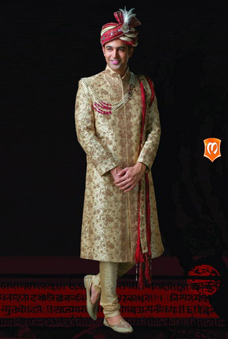The Manyavar silk embroidered sherwani :- This sherwani weaved on dupion silk is in the shade of fawn brown is an arena full of stones sequins, embroidery and thread work describing its design with intricacy. #Sherwani #Manyavar #Wedding #Ethnic Wear #Manyavar Wedding Wear #Indian Wedding Wear #Wedding Collection #Manyavar Sherwani