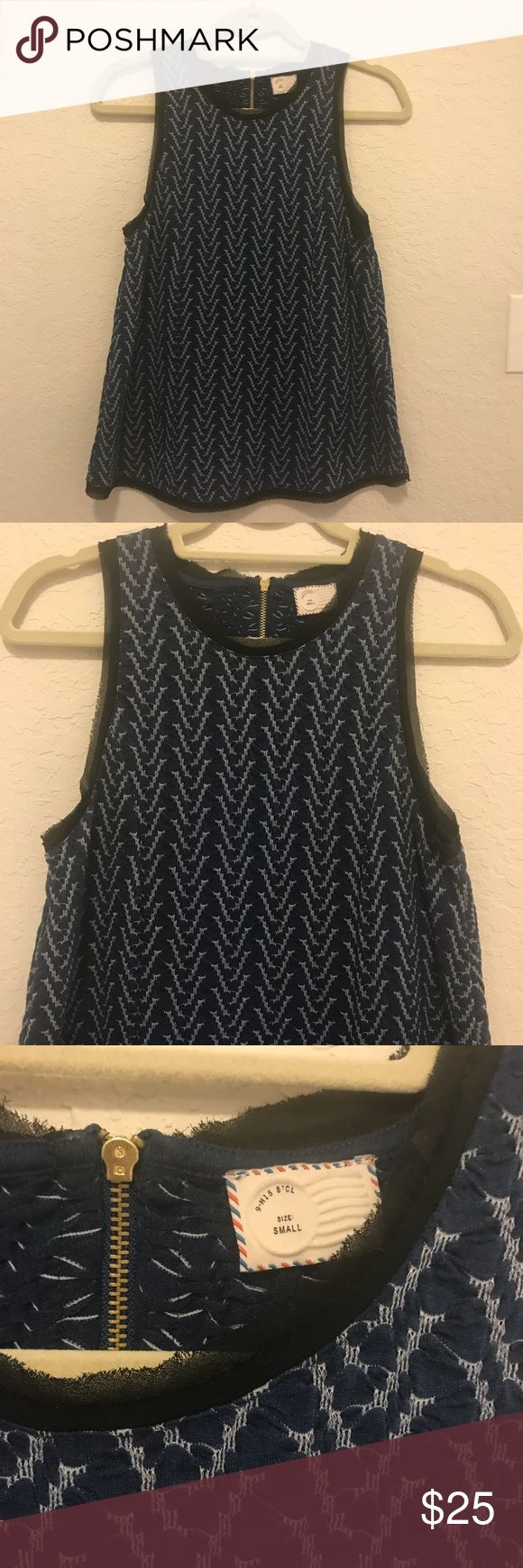 Anthropologie blue chevron top Anthropologie blue chevron top with exposed back zipper. Worn once. Great condition! Anthropologie Tops Blouses