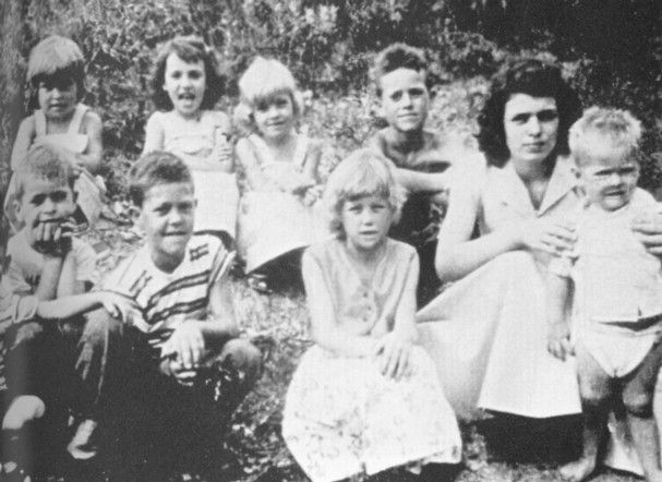 Avie Parton In An Undated Photograph With In Front Row