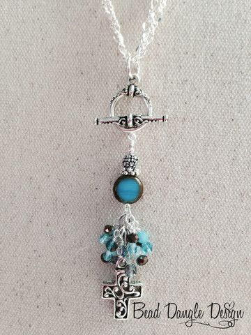 Turquoise and Brown Crystal Cross Beaded Dangle Necklace