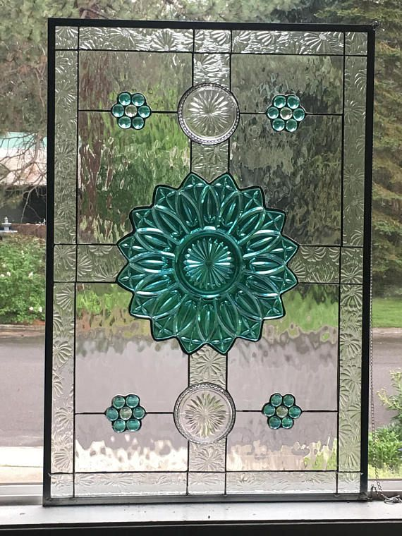 Stained glass transom window with vintage teal plate and
