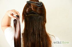 How to apply hair extensions, this gives step by step instructions for clip in and glue in extensions.
