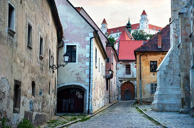 Slovakia - Bratislava, picture of old city center with houses in poor state but painted in old beautiful painting and having interesting shapes #trivo