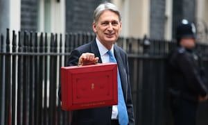 Britain's chancellor of the exchequer, Philip Hammond, holds the red case as he departs 11 Downing Street to deliver his budget to parliament on Wednesday