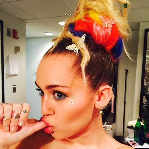 Another MK-inspired Miley Cyrus Instagram pic. In this pic: Butterflies in her hair (Monarch programming), sucking her thumb as if she was broken down to the state of an infant and showcasing her triangle and all-seeing eye tatoos.