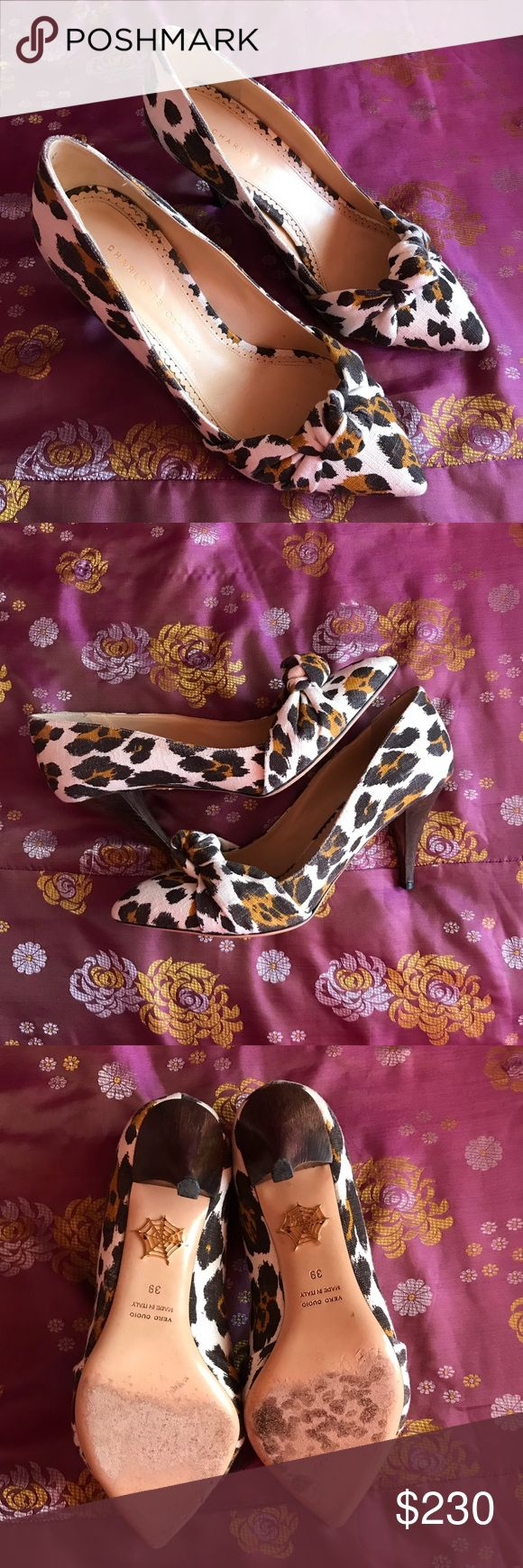 Charlotte Olympia Pumps Canvas leopard pump with a three inch dark wooden heel. They are light, comfy, and fun! Heels are white with a black and brown Leopard print. Charlotte Olympia Shoes Heels