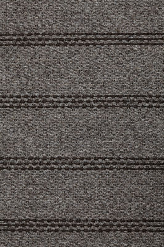 Heywood in Chocolate - Undyed Loam and Thin Felted Chocolate - Customizable with all yarn colors. Heywood combines the hand-stitched look of a bespoke suit with a toothy weave structure to create an irresistible textural effect. A flatweave rug made from undyed heathered and felted wools, Heywood is available in 3 rich colorways: Dark Gray, Chocolate and Jade. John J. Heywood established the Heywood Narrow Fabric Company on Portland Street in Fall River in 1890.