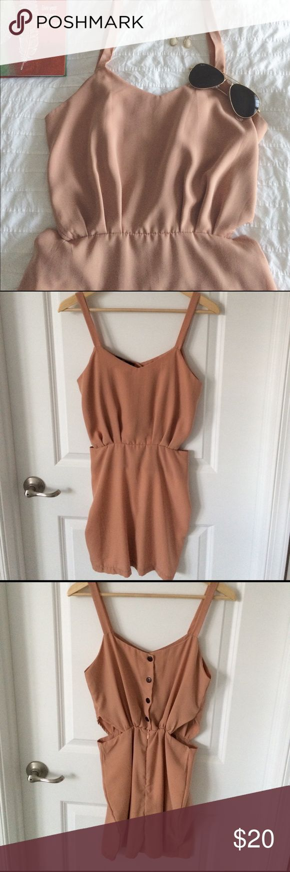 Nude Short Dress This is such a cute dress with zipper and buttons on the back side of the dress. Cut out details on both sides to show off your waist. This dress was a little tight on me as I normally wear a medium/ size 6. New but tags have been taken off. Dresses Mini