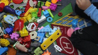 Child playing with a lot of toys at kindergarten.