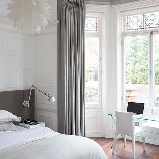 White bedroom with home office. If space is at a premium, consider creating a home office by an unused window. Place a desk in the window so you can gaze out at the view while you ponder on an email. In a mostly white room, feel free to add in other neutral colours to warm the space up a bit. #Sleeptember